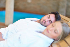 Beautiful couple relaxing together at spa centre after a beauty treatment Royalty Free Stock Images