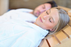 Beautiful couple relaxing together at spa centre after a beauty treatment Royalty Free Stock Photo