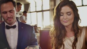 Beautiful couple in a restaurant stock footage