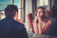 Beautiful couple in a restaurant.  royalty free stock photos