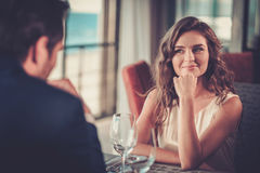 Beautiful couple in a restaurant Royalty Free Stock Images