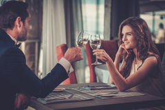 Beautiful couple in a restaurant stock photo