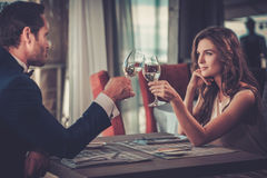 Beautiful couple in a restaurant.  royalty free stock photography