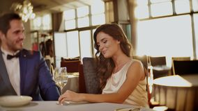 Beautiful couple drinking wine in a restaurant stock video footage