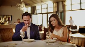 Beautiful couple eating dessert in a restaurant stock footage