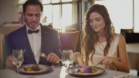 Beautiful couple in a restaurant stock video footage