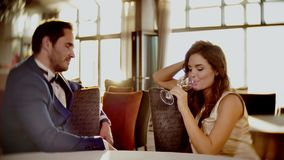 Beautiful couple drinking wine in a restaurant stock footage