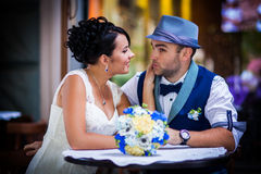 Beautiful couple in the restaurant, hat. Stylish Autumn wedding a beautiful bride and brave groom Stock Photography