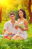 Beautiful couple resting on grass in evening instagram stile Royalty Free Stock Photography