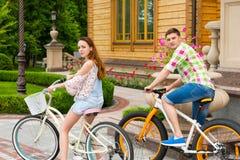 Beautiful couple riding bikes Stock Photos