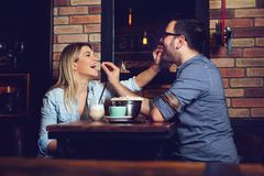 Beautiful couple on a romantic date in cafe. Young Beautiful couple on a romantic date in cafe stock photography