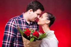 Beautiful couple with a roses bouquet in hands Stock Photos