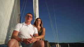 Beautiful couple is sailing river together in summertime. stock video footage
