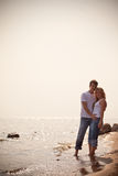 Beautiful couple on a seashore Royalty Free Stock Image