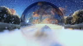 Beautiful couple seen through a glass orb, snowing, zoom out stock video footage
