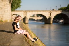 Beautiful couple on the Seine embankment Royalty Free Stock Photo