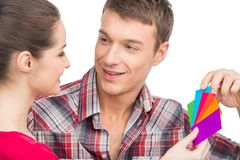 Beautiful couple selecting color and smiling. Royalty Free Stock Photo