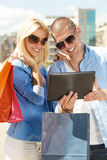 Beautiful couple shopping  online Royalty Free Stock Image