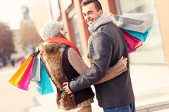 Beautiful couple shopping together Royalty Free Stock Image