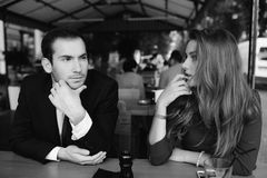 Beautiful couple sitting in the cafe Stock Images