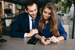 Beautiful couple sitting in the cafe Royalty Free Stock Images