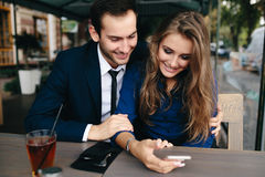 Beautiful couple sitting in the cafe Royalty Free Stock Photo