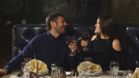 Beautiful couple sitting in a fancy restaurant and talking stock video