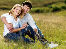 Beautiful couple sitting in meadow stock photos