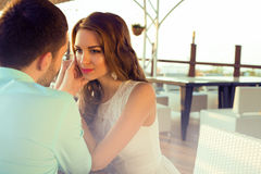 Beautiful couple sitting in a restaurant and looking at each other Stock Photography
