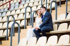 Beautiful couple sitting and watching football Stock Photography