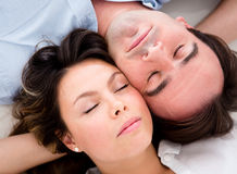 Beautiful couple sleeping Stock Photos