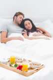 Beautiful couple sleeping in their bed Royalty Free Stock Image