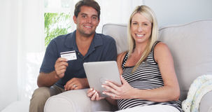 Beautiful couple smiling after buying baby supplies stock photos