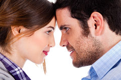 Beautiful couple smiling and facing each other Royalty Free Stock Photo