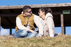 Beautiful couple smiling and hugging  on a meadow Royalty Free Stock Photography