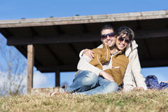 Beautiful couple smiling and hugging  on a meadow Royalty Free Stock Photo