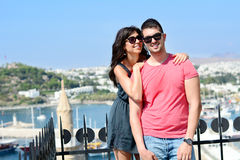 Beautiful couple smiling and hugging  on sea resort background Royalty Free Stock Photography