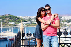 Beautiful couple smiling and hugging  on sea resort background Stock Photo