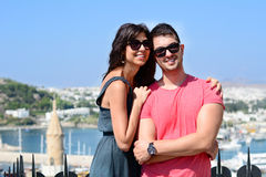 Beautiful couple smiling and hugging  on sea resort background Royalty Free Stock Photo
