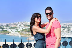 Beautiful couple smiling and hugging on sea resort background Stock Photos