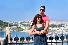 Beautiful couple smiling and hugging on sea resort background a Stock Photos