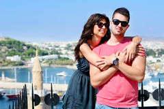 Beautiful couple smiling and hugging  on sea resort background Stock Images