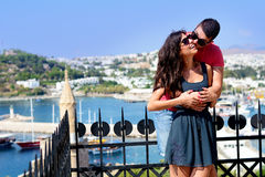 Beautiful couple smiling and kissing on sea resort background Stock Image