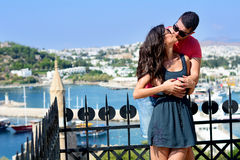 Beautiful couple smiling and kissing on sea resort background Royalty Free Stock Image