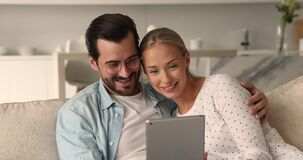Beautiful couple spend time buying on internet using tablet device