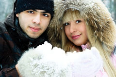 Beautiful couple spending time in winter park Stock Image