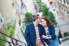Beautiful couple on the stairs of Montmarte Stock Photography