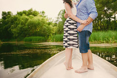 Beautiful couple standing on the bow of the boat in the lake, lifestyle, leisure, youth Royalty Free Stock Photography