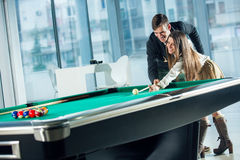 Beautiful couple standing next to the pool table Stock Photo