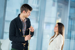 Beautiful couple standing next to the pool table Royalty Free Stock Photos